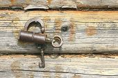 Old Mechanical Lock And Wooden Wall