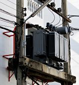 Grey Transformer Mounted On Power Poles