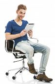 Good looking young man working on a tablet, isolated on white background