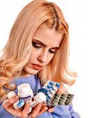 Sad woman having flu takes pills. Isolated.
