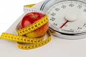 on a personal scale is an apple. photo icon for slimming and healthy, vitamin-rich diet.
