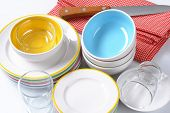 set of porcelain dinnerware - plates, soup bowls and glass