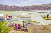 PUNO, PERU, MAY 5, 2014:  Port on Lake Titicaca with colorful pedalos to hire