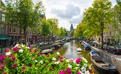 AMSTERDAM - AUGUST 29: Canal in old city at daytime on August 29, 2014 in Amsterdam.