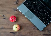 laptop and two apples