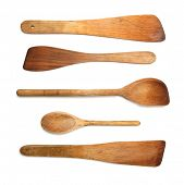 Old wooden spoons and stirrers on white background.