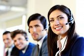 Smiling businesspeople in a call center office