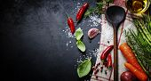 foto of italian food  - Wooden spoon and ingredients on dark background - JPG