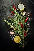 Bunch of spices on dark vintage background. Cooking, vegetarian food or health concept.