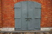 Steel Door Gray With Red Bricks.