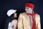 picture of sherwani  - Two Indian models having a light moment over a joke during a shoot - JPG