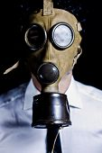Man in shirt and tie with a gas mask