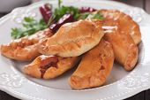Baked empanadas, popular Latin American food served as snack or appetizer