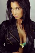 beautiful brunette with a leather jacket