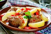 stock photo of pork cutlet  - meat cutlets baked with potatoes tomatoes and red pepper - JPG