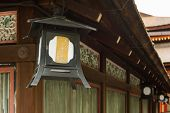 The lantern hanging under the eaves in Yasaka Shrine in Kyoto.