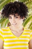 Young woman with curly hair and shirt with yellow stripes. Work Path.
