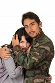 picture of say goodbye  - young woman and soldier in military uniform say goodbye deployment isolated on white - JPG