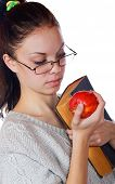 The Girl With The Old Book And An Apple On A White Background