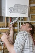 stock photo of plumber  - Plumber at work - JPG