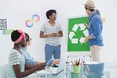 Young creative team having a meeting about recycling in creative office