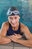 Portrait of a fit female swimmer in the pool at leisure center