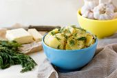 Boiled sliced potatoes with fresh dill