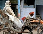 A rickshaw being pulled in Varanassi, India