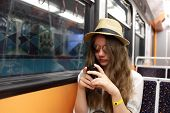 Girl With Phone In Subway Train