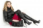 foto of woman boots  - sitting woman wearing fashionable clothes and boots with a handbag - JPG