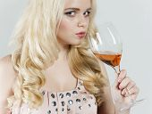 portrait of young woman drinking rose wine