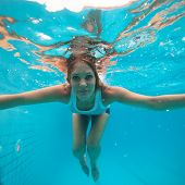 Female With Eyes Open Underwater In Swimming Pool