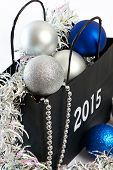 Christmas Balls And Tinsel In Gift Bag Symbol Of New Year Isolated
