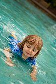 Little girl in a public pool for kids