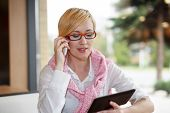 Young Manager Call By Phone And Check Tablet