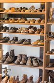 Shelf With Old Shoes