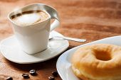 Appetizing Cup Of Coffee With Doughnut.