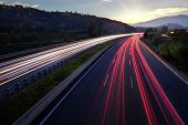 Light Beams Of Vehicles On Highway.