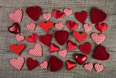 Lovely red checkered hearts on wooden background. Idea for a greeting card: valentines, wedding, birthday or christmas.