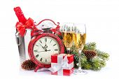 Champagne, gift boxes and christmas clock. Isolated on white background