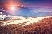 Amazing evening winter landscape. Carpathian, Ukraine, Europe. Retro style filter. Instagram toning effect.