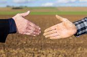 Handshake Between Businessman And Farmer