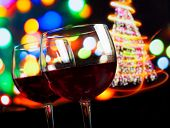 Red Wine Glass Against Bokeh Lights Tree Background