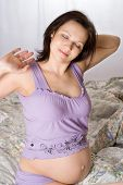 Pregnant Woman Embracing Stomach