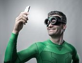 Superhero Taking A Selfie With A Smartphone