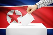 Voting Concept - Ballot Box With National Flag On Background - North Korea