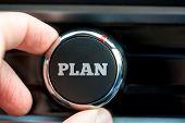 Man Turning On A Plan Button