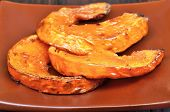 Slices Of Baked Pumpkin With Honey
