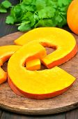 Fresh Pumpkin Slices On Cutting Board