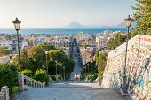 foto of descending  - Staircase descending into a city Patras Greece - JPG